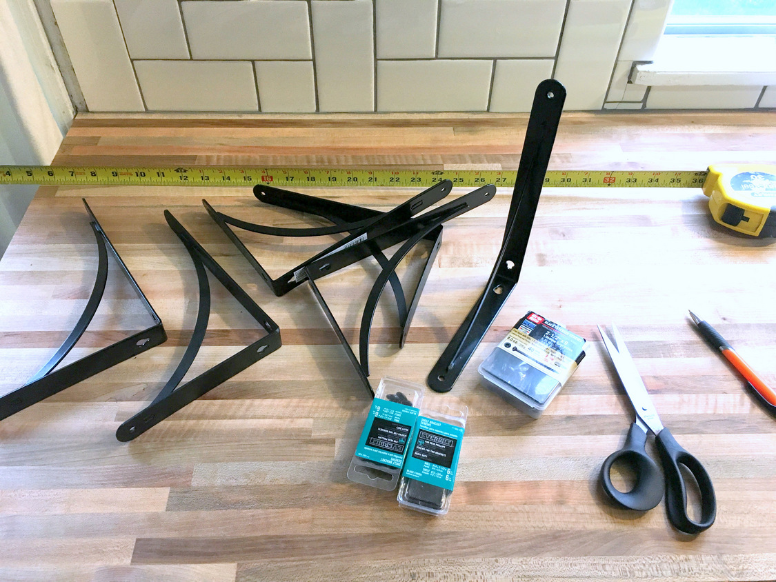How to install basic open kitchen shelves over tile a tile note before installing the tile we had measured and noted the stud location so we knew we would drill into the studs with our brackets dailygadgetfo Image collections