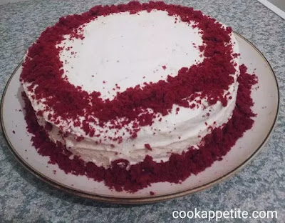 This is the recipe I use for both cupcake recipe and layer cake recipe, it never disappoints. I love my red velvet cake with cream cheese frosting. It always gives me a buttery, moist and soft cake. A two layer red velvet cake with frosting made from scratch. A velvet cake is a perfect treat on Christmas and other special occasions.