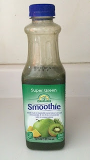 A half-empty bottle of Nature's Nectar Super Green Smoothie, from Aldi