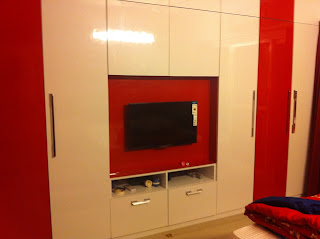 Wardrobe in Hi Gloss with integrated TV unit and concealed wiring