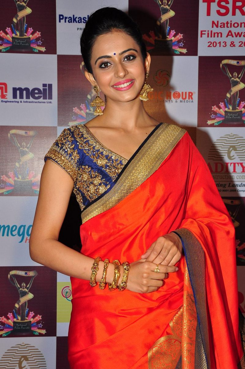 Glamours Tollywood Queen Rakul Preet Singh Navel Show Photos In Traditional Orange Saree