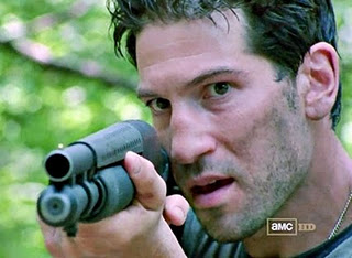 Shane Walsh aiming his shotgun at Rick in Season 1 of The Walking Dead