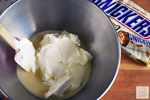 Easy SNICKERS® Ice Cream | by Life Tastes Good is no churn, so that means no special equipment needed! Anyone can make this creamy, delicious frozen treat! I love how smooth and creamy no churn ice cream is too!