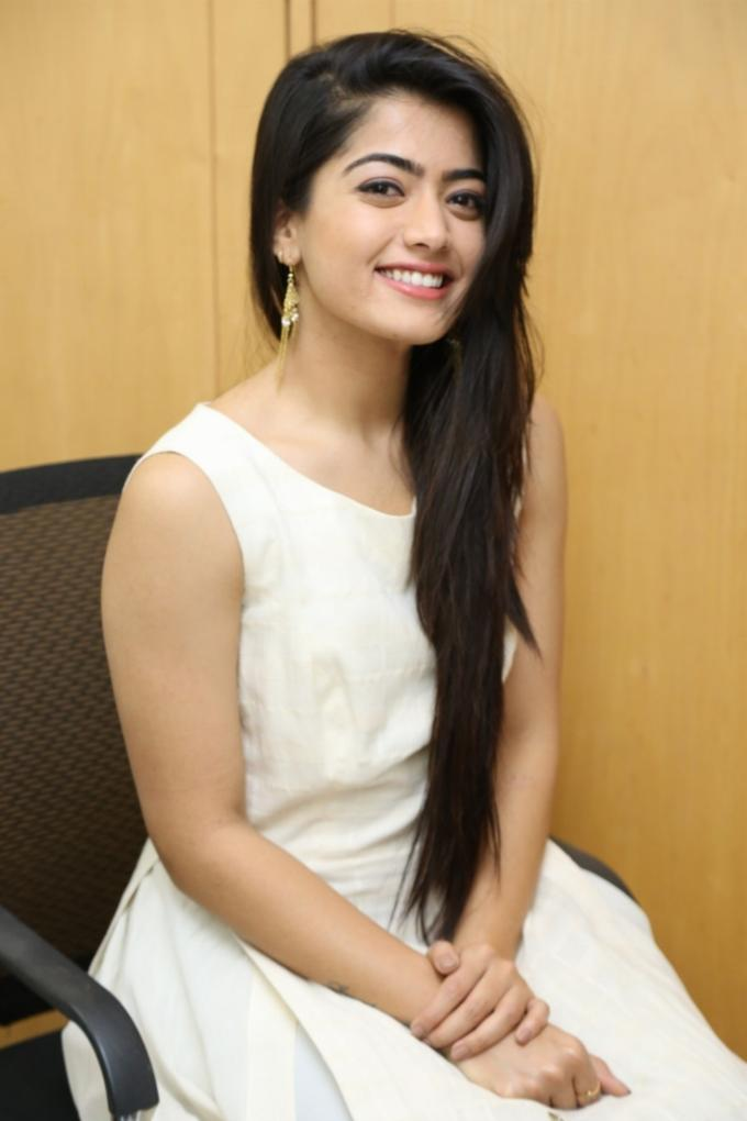 Indian Hot Model Rashmika Mandanna Long Hair Smiling Stills In White Dress