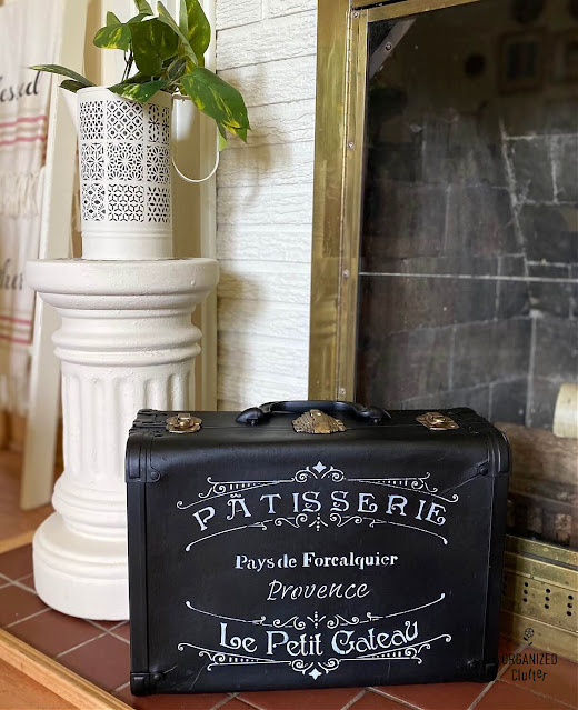 Photo of a vintage suitcase upcycled with paint and a French stencil