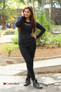 Actress Aswini Latest Stills in Black Denim Jeans  0188.JPG