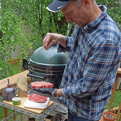Seasoning Certified Angus Beef Brand ribeye steaks with my Umami Steak Seasoning