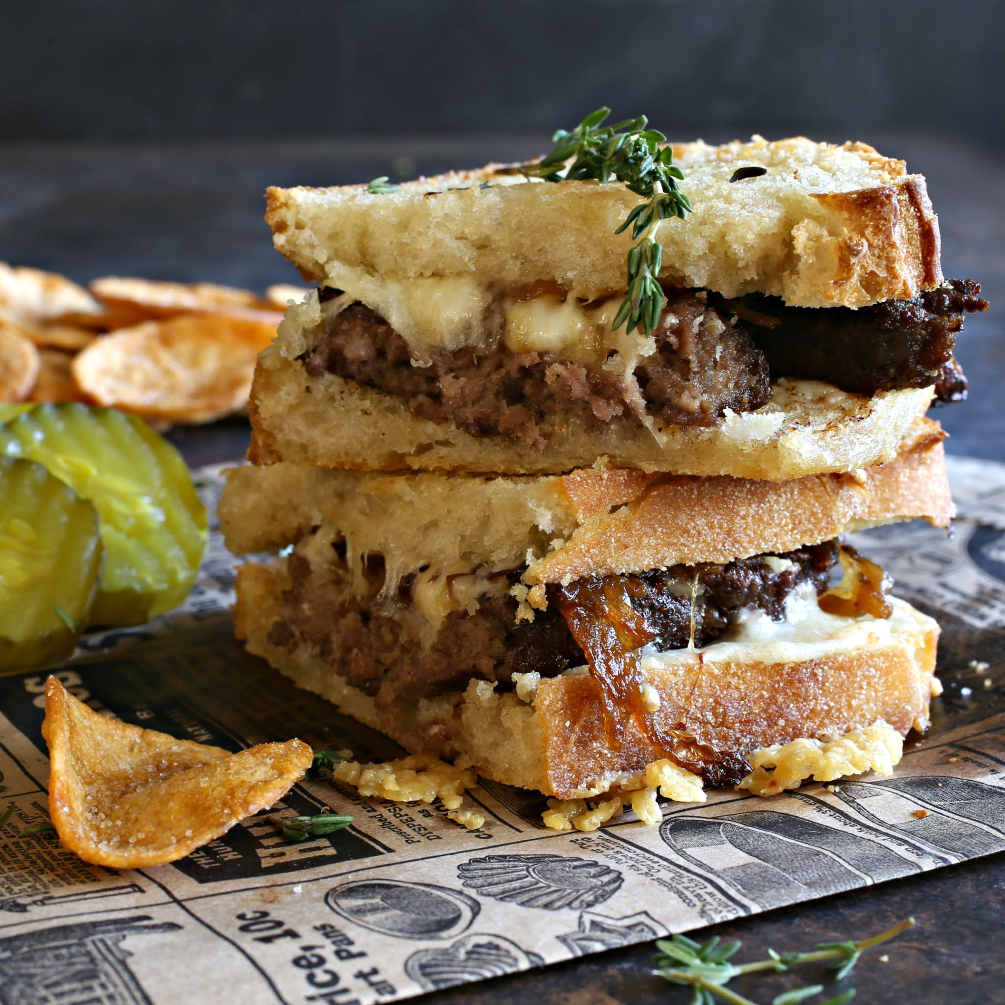 Grilled beef and Gruyere sandwich melts with caramelized onions