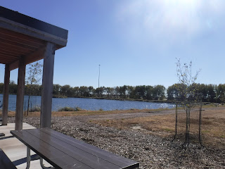 shelter, picnic tables, and pond at Prairie Park in Sioux City, Iowa