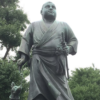 Bronze statue of Saigo Takamori dressed in Yukata with his trusty hunting dog by his side