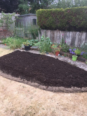 Filling the bed with topsoil and compost