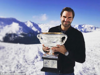 Photos: Roger Federer shows off Australian Open trophy on top of a Swiss mountain