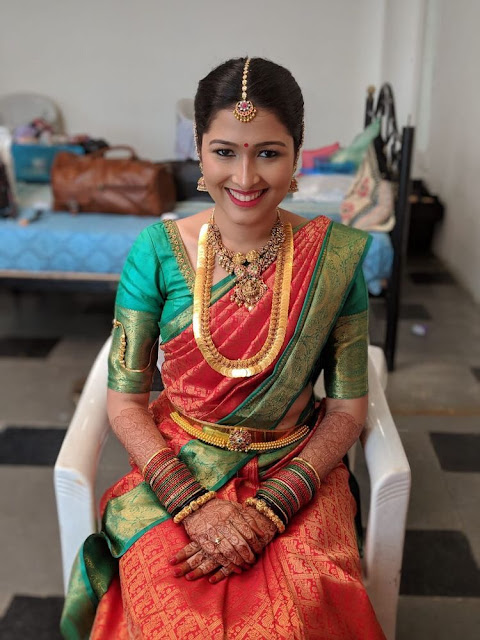 Bride in Heavy Kasu Mala Choker and Simple Waistbelt