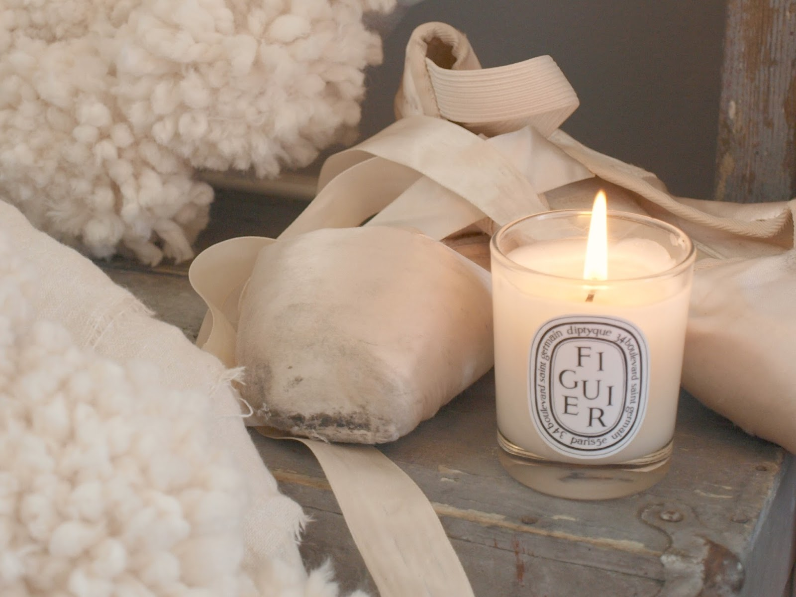 Diptyque candle, pink pointe shoe and cozy white handmade woolly pom pom wreath