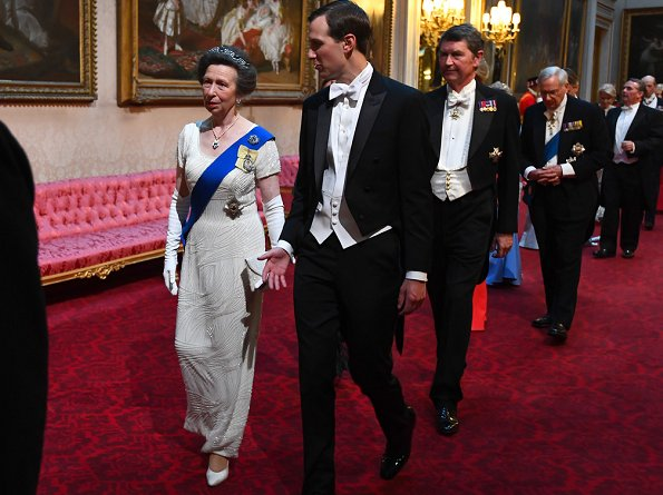 The Duchess wore a bespoke Alexander McQueen ruffled gown and Sapphires, Regalia and the Lover's Knot Tiara