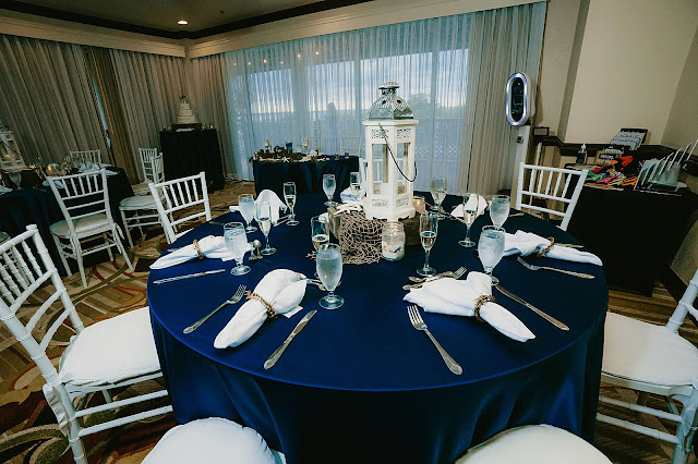 Reception Detail shot of blue table clothed tables with white chairs