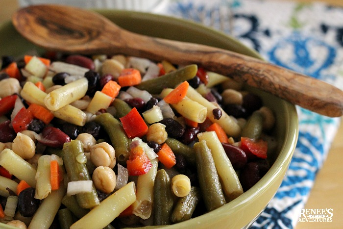 Mixed Bean Salad by Renee's Kitchen Adventures in green bowl with wooden spoon