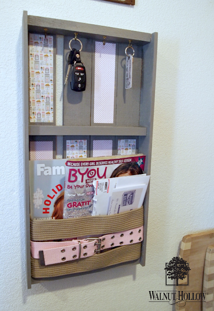 Cinch in your clutter with this Belted Wall Organizer via Walnut Hollow!