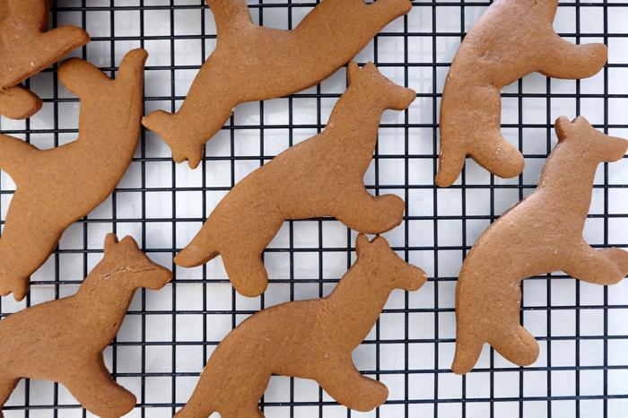 German Shepherd shaped gingerbread cookies cooling on rack