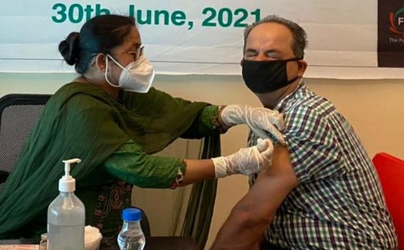 A person getting vaccine during Mass Vaccination Camp by FICCI FLO Amritsar