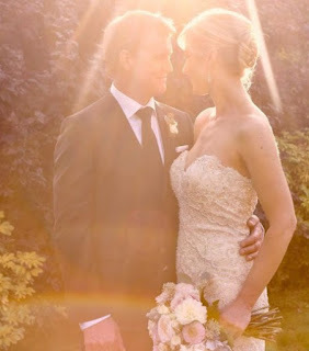 Anne Drewa with her husband in their wedding dress