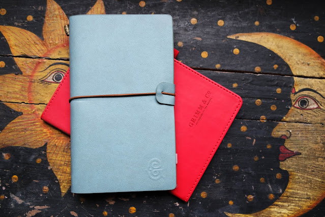teal and red notebooks