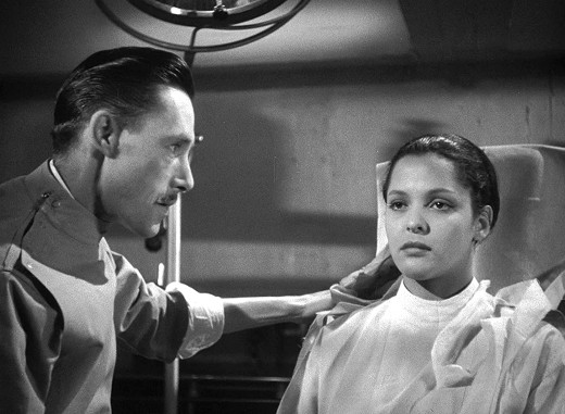 John Carradine and Acquanetta in Captive Wild Woman, 1943