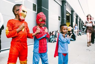 Kids dressed in superhero costumes at Comic Con 2018