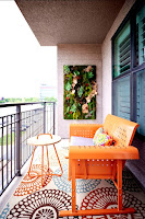 Apartment balcony design ideas with orange seat and lovely decoration set