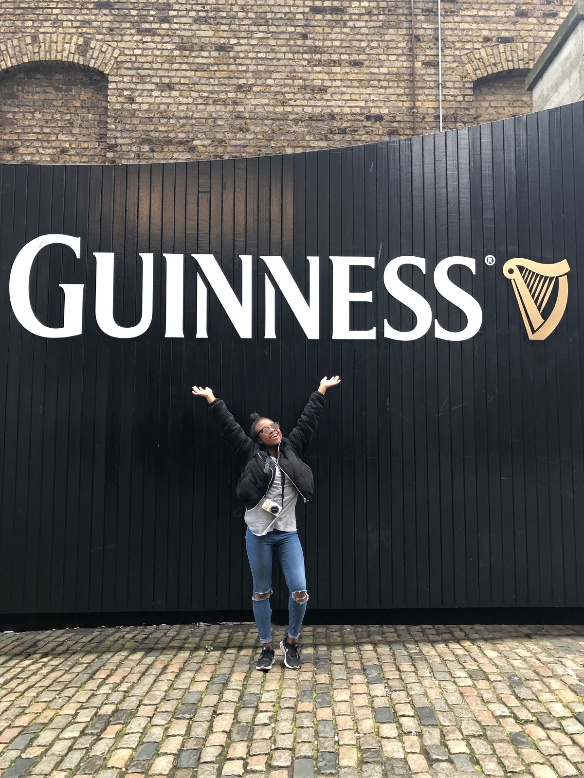 Posing outside the Guinness storehouse in Dublin