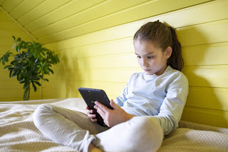 Girl reclining with her ipad