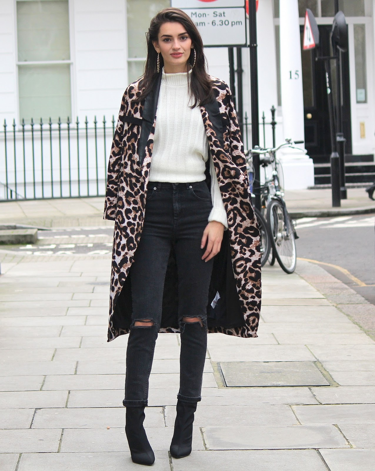 peexo fashion blogger wearing winter outfit including leopard print coat