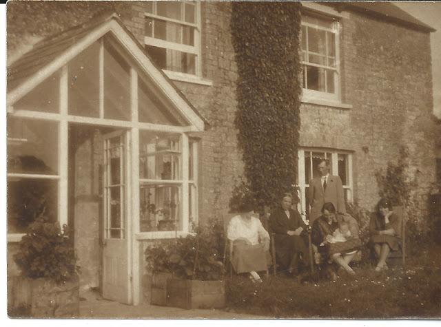 Family Group outside the farm house