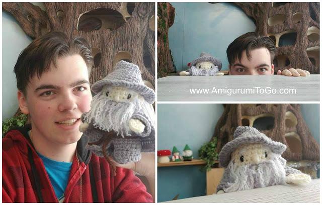 a boy with crochet gandalf doll