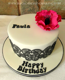 Black white and pink birthday cake