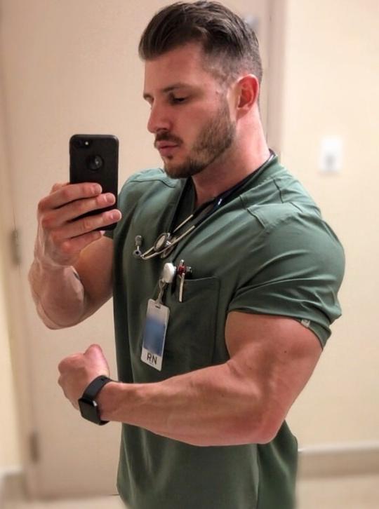 sexy-beefy-muscle-male-nurse-uniform-mirror-selfie-flexing-huge-biceps