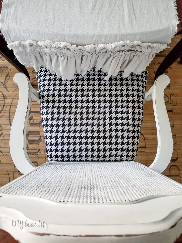 white chair with houndstooth pattern seat cushion