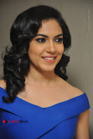 Actress Ritu Varma Pos in Blue Short Dress at Keshava Telugu Movie Audio Launch .COM 0078.jpg