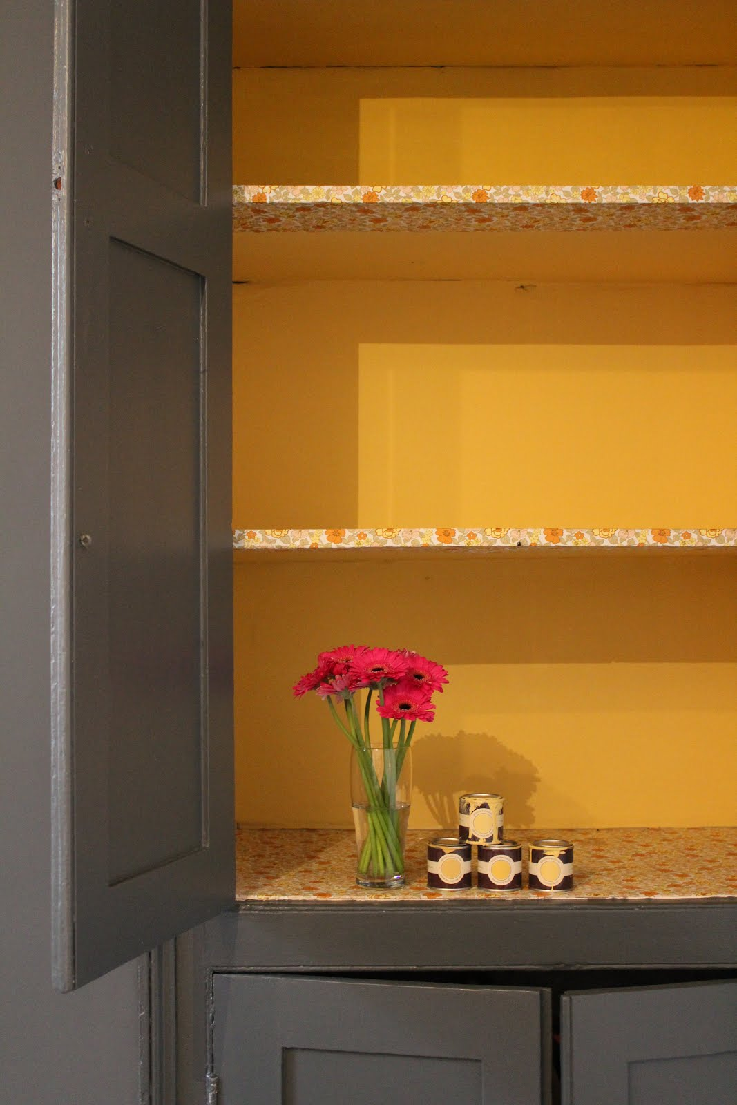 Yellow Inside Cupboard with Farrow and Ball Downpipe