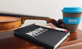 Coffee cup, folder and fiddle with Blazing Fiddles written on