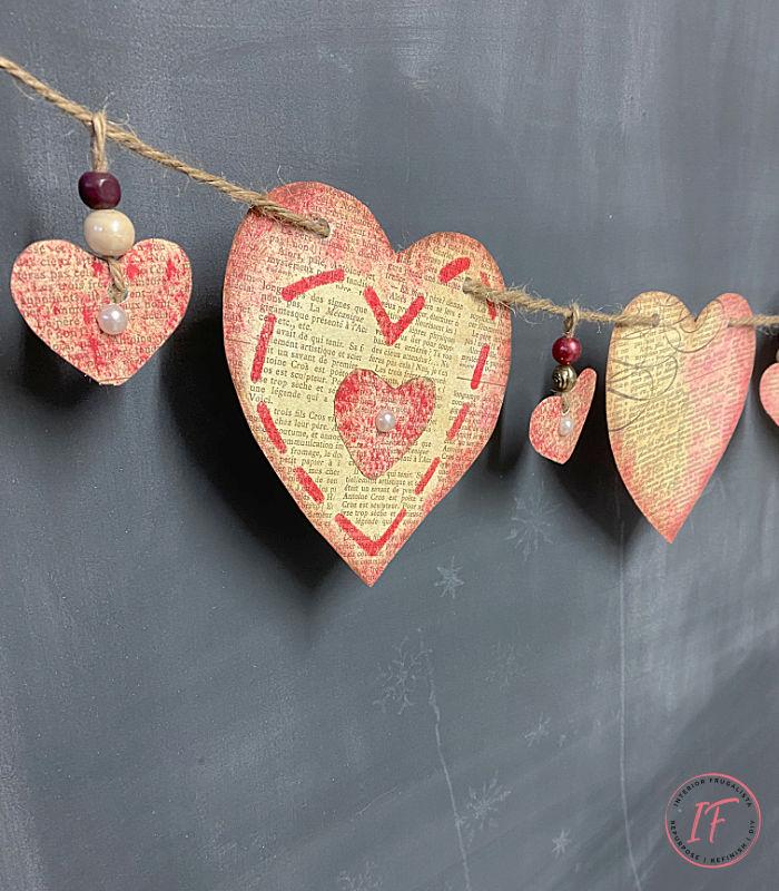 How to make a simple Victorian Vintage-style Valentine heart banner with newsprint scrapbook paper. A budget-friendly Valentine mantle garland craft.