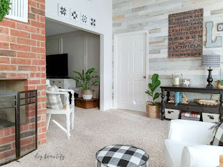 A light, bright and airy sunroom with reclaimed wood walls   diybeautify.com