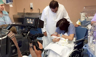 Image: Maria cradles her new baby boy with her husband Enzo look on. Picture: Australscope