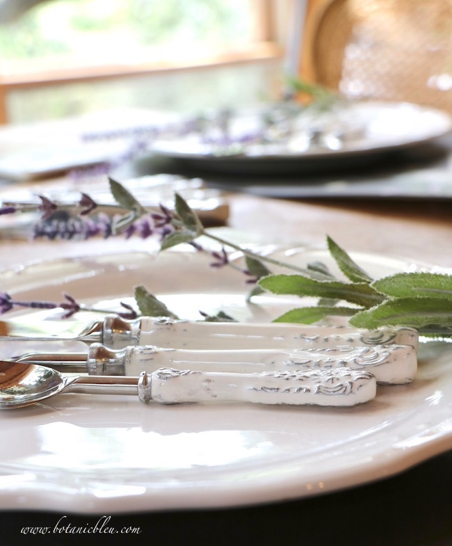 Whimsical Summer Lavender Tablesetting uses white dishes and white flatware to keep the table looking cool