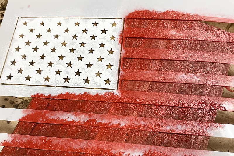 stencil of an American flag with red paint