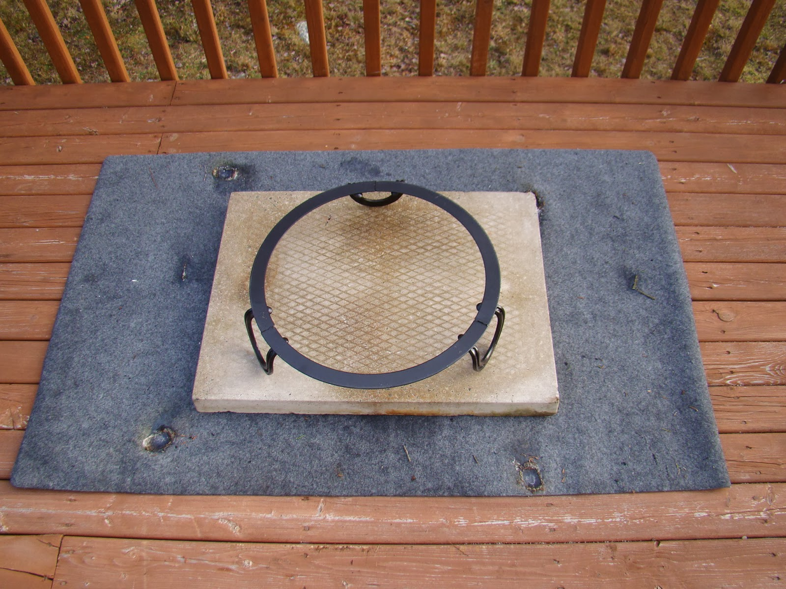 bbq heat resistance mat on the deck then on top of it a patio stone if you donu0027t do this the heat from the cooker can cause your deck to ketch fire