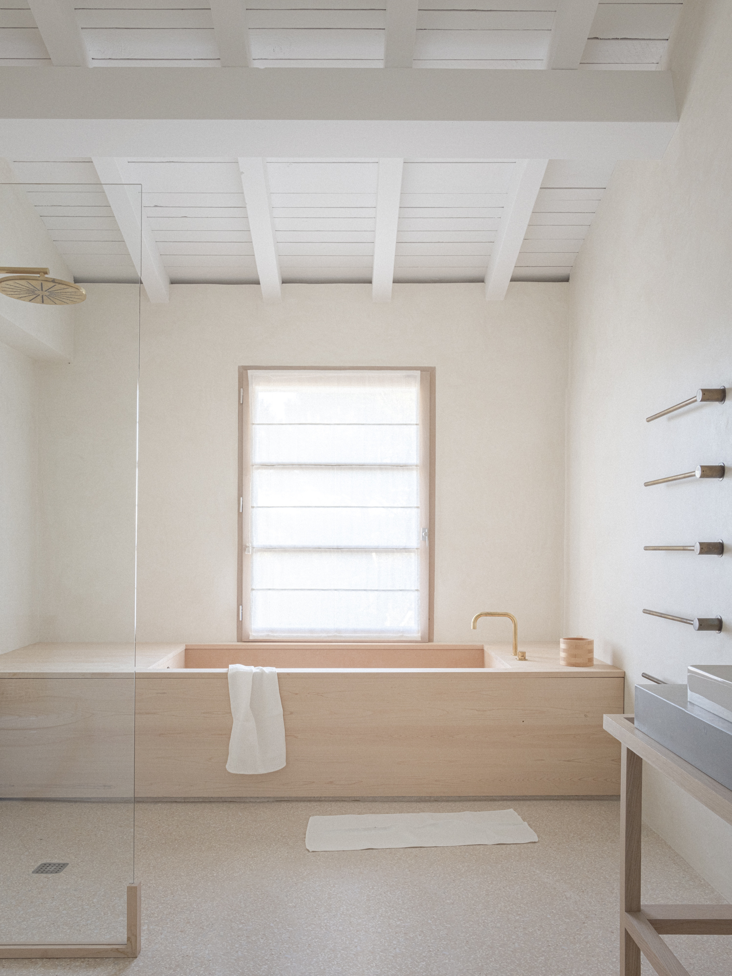 wooden bathtub and terrazzo floor for a minimal bathroom