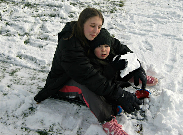 Boy and girl in the snow