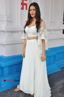 Telugu Actress Amyra Dastur Stills in White Skirt and Blouse at Anandi Indira Production LLP Production no 1 Opening  0016.JPG