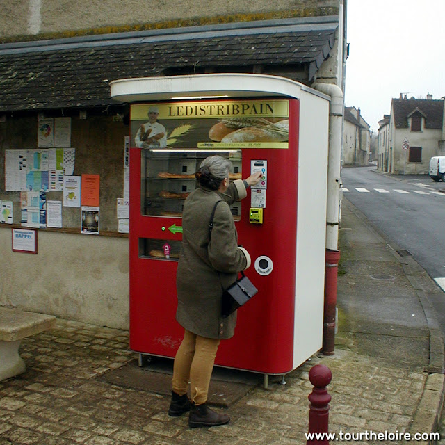 Using a baguette vending machine, Indre et Loire, France. Photo by Loire Valley Time Travel.